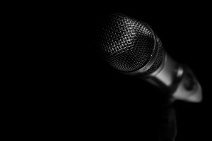 Microphone on a black background.
