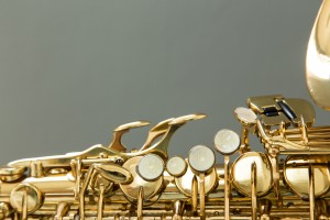 Saxophone on a gray background